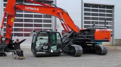 The cab of this Hitachi ZX210LC-5 has been modified to allow easy access to wheelchair users.