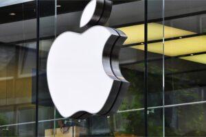 Apple logo sign on glass storefront