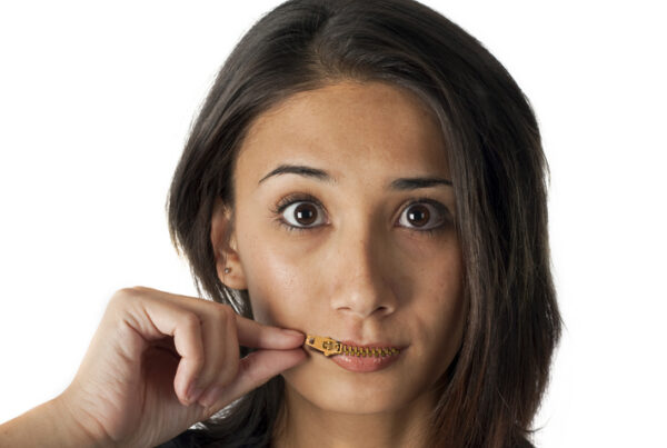Woman with a closed zipper photoshopped in her mouth